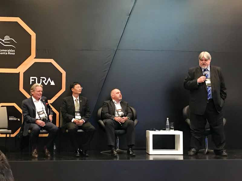 The Gemological Institute of America's (GIA's) Shane McClure (right) led a panel discussion on origin, with Claudio Milisenda (DSEF), Taijin Lu (NGTC), and Kenneth Scarratt (DANAT).