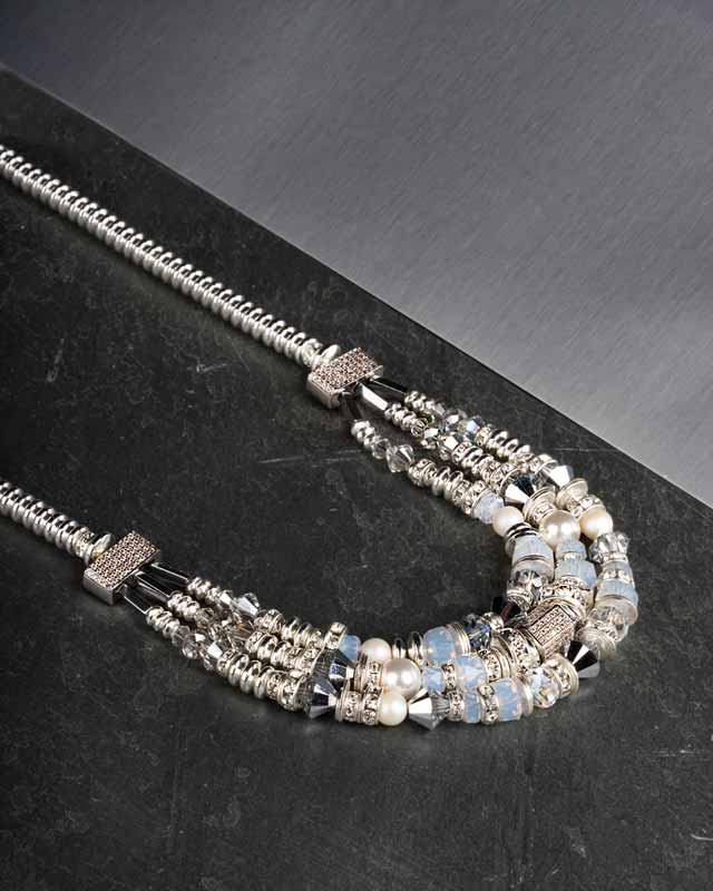'Tenley' statement necklace by Hillberg & Berk in sterling silver with white opal, hematite, and Swarovski pearl.
