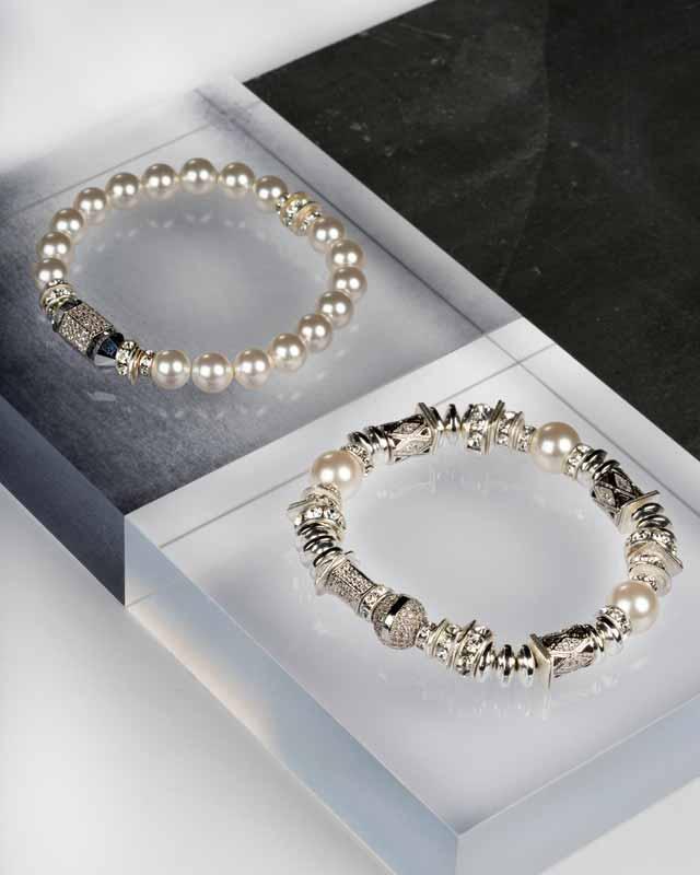'Nyx' stretch bracelet in sterling silver and Swarovski pearl and 'Nola' stretch bracelet in sterling silver, Swarovski pearl, and coated hematite by Hillberg & Berk.
