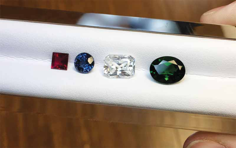 From left to right: rubellite, spinel, zircon, and diopside.