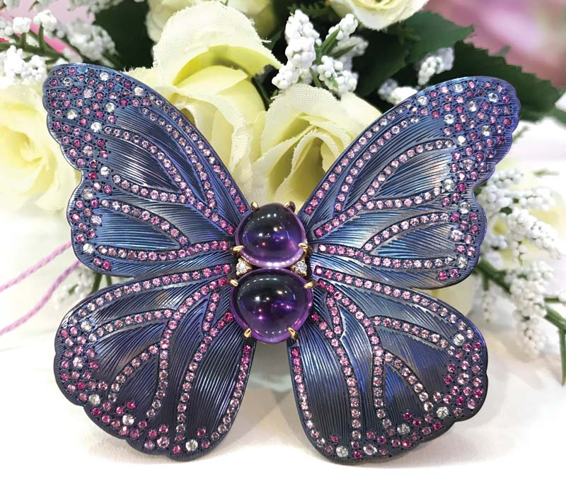 'Butterfly' brooch in titanium set with amethysts, sapphires, and diamonds by Japanese designer May Jewelry.