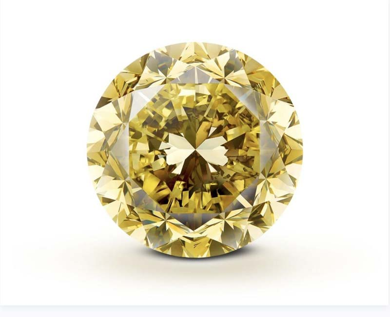 The 54.21-carat round brilliant-cut, fancy vivid yellow 'Mouawad Dragon' diamond is being called the largest of its kind in the world.