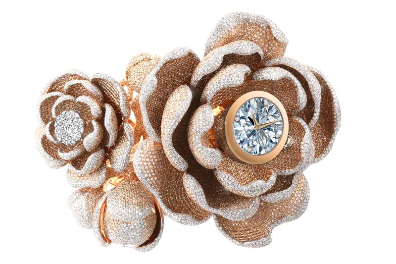 With 15,858 diamonds, Coronet's 'Mudan' timepiece set the Guinness World Record for most diamonds ever set in a watch.