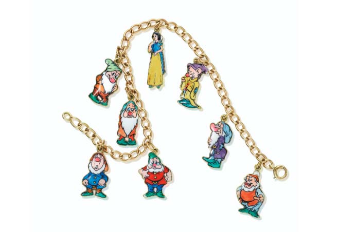 A Snow White and the Seven Dwarfs charm bracelet by Cartier sold for seven times its estimate.
