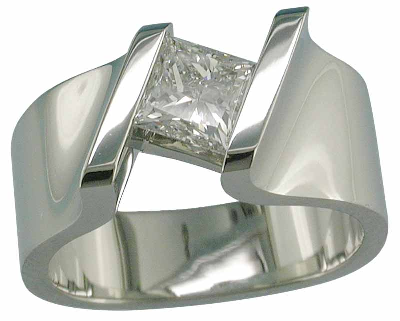 A 19-karat white gold ring that is channel-set with a princess-cut diamond.