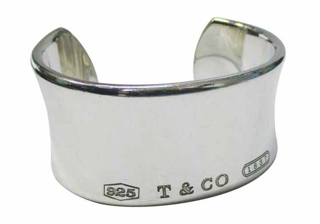 Appraisers should have extensive knowledge of famous designers, along with their authentic trademarks and master design concepts. The branding on this Tiffany cuff bracelet shows the piece is authentic.