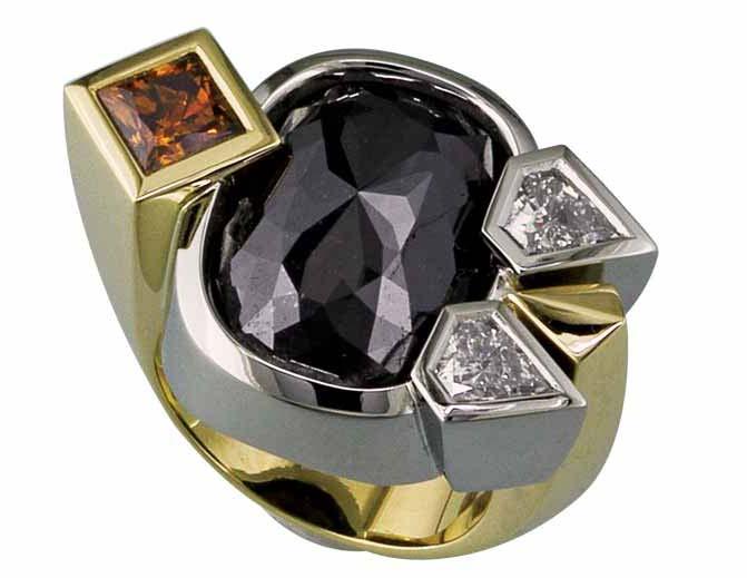 An 18-karat yellow gold and 19-karat white gold ring set with a 15.92-carat rose-cut black diamond centre stone, a 1.05-carat princess-cut natural fancy orange-brown diamond, and two kite-shaped white diamonds (0.93 ctw).
