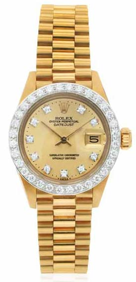 Ladies' diamond and 18-karat gold 'Oyster Perpetual Datejust' wristwatch by Rolex, circa 1979. This piece features an automatic movement, diamond bezel, gilt dial with diamond dot numerals, sweep seconds, magnified date aperture, and Rolex President bracelet with déployant clasp. Photo courtesy Dupuis Fine Jewellery Auctioneers