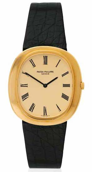 'Ellipse' wristwatch by Patek Philippe featuring an automatic movement, cushion-shaped case with brushed-finish bezel, matte gilt dial, and black leather strap in 18-karat gold. Circa 1970.