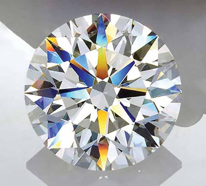Round diamond with excellent brilliance, fire and symmetry. Photo© Michael Cowing, ACA Gem Lab