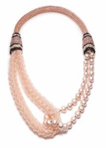 Blush freshwater pearls and seed beads with vinyl lacing by Barbara Stutman.