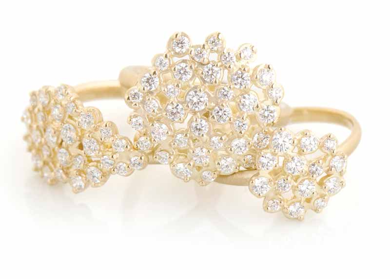 Handmade gold 'Festival' rings by Anne Sportun with clusters of round brilliant-cut diamonds.