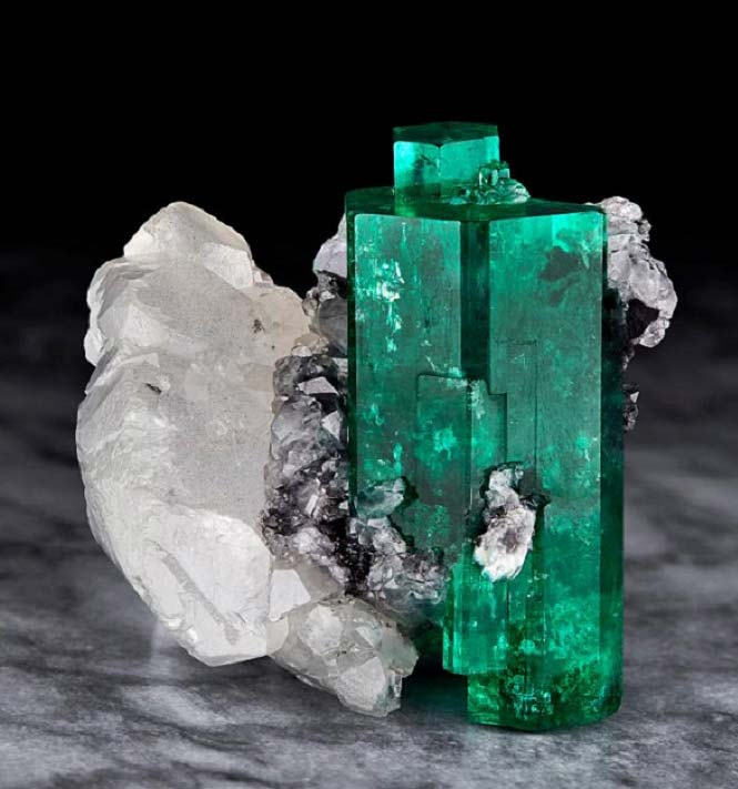 Emerald on calcite from Colombia's Muzo Mine.