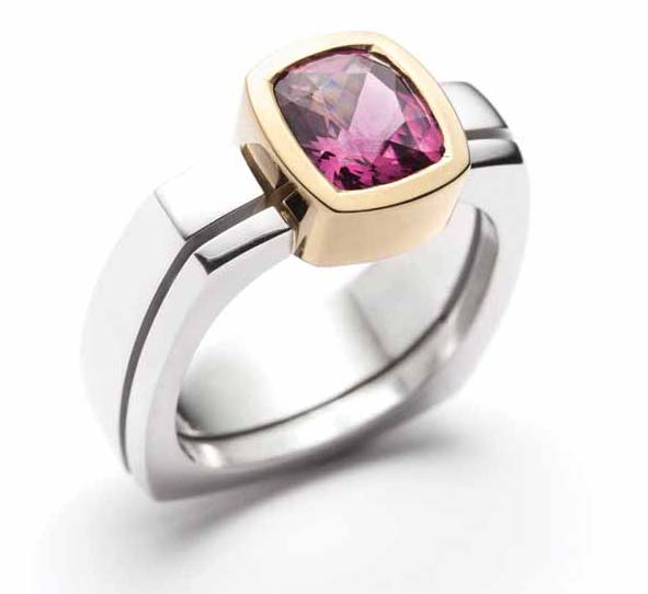 18-karat gold and 925 silver ring by Christine Dwane, featuring a rhodolite garnet centre stone.