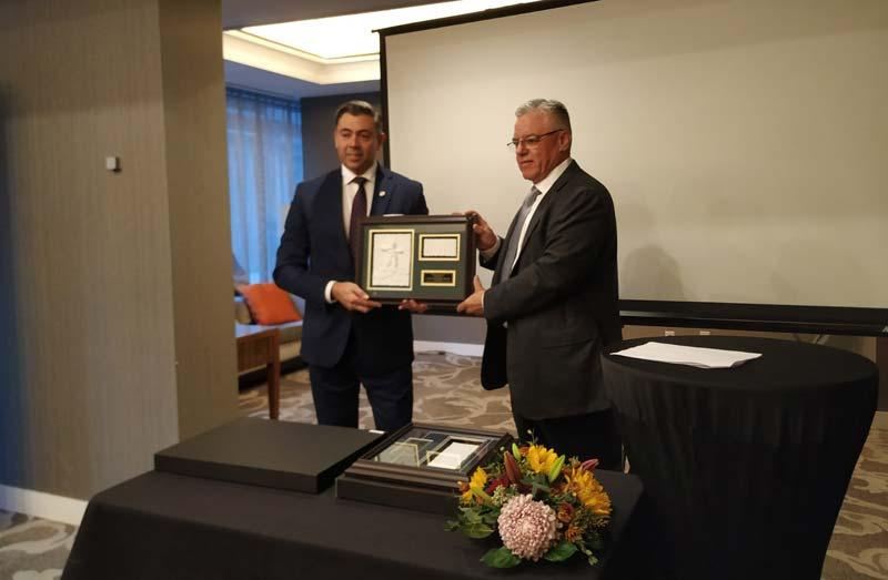 John Minister receives the Erol Paylan Memorial Award.