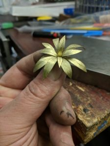 The palm fronds were hand-fabricated from thin sheets of 18-karat green gold.