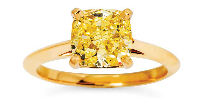 A yellow diamond solitaire and gold ring by Tiffany & Co.