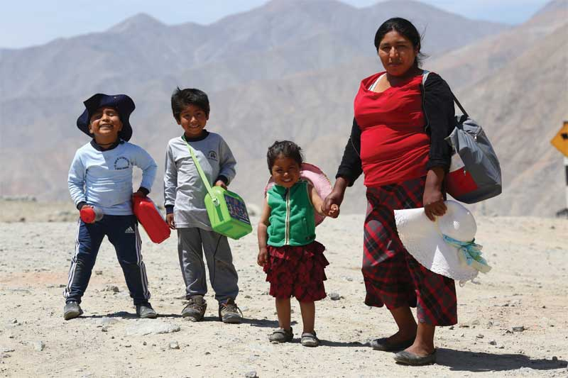 Families of miners enjoy better education and health care. Photo courtesy Alan Frampton/MacDesa
