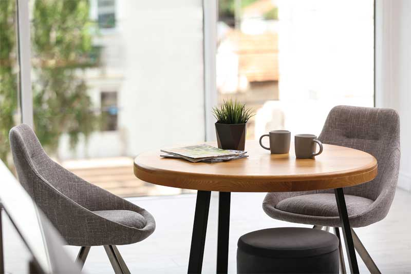 When introducing custom design to your store, consider adding a consultation space with a table and chairs to create a more private setting.