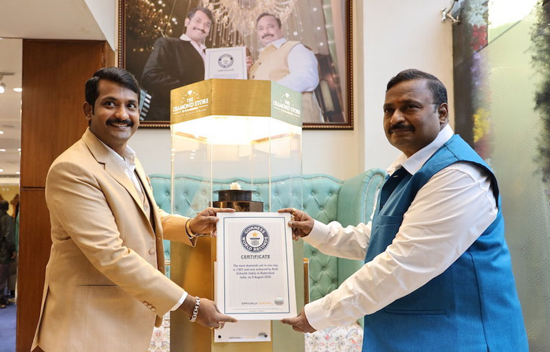 Kotti Srikanth, pictured with his father, Chandubhai, achieved the record. Photo courtesy the Diamond Store by Chandubhai