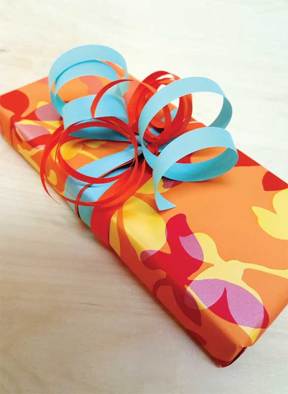 A delightful option is to add colour and excitement to packaging using eco-friendly ribbons and bows. Photos courtesy Cream City Ribbon