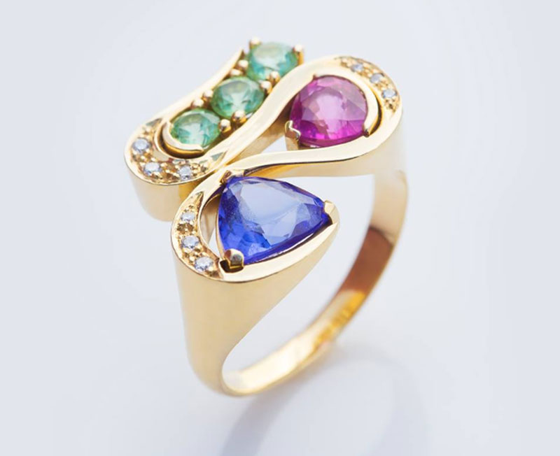 Tourmaline and diamond engagement ring with a tanzanite and garnet, set in 18-karat yellow gold. Photo by Rippana Inc.