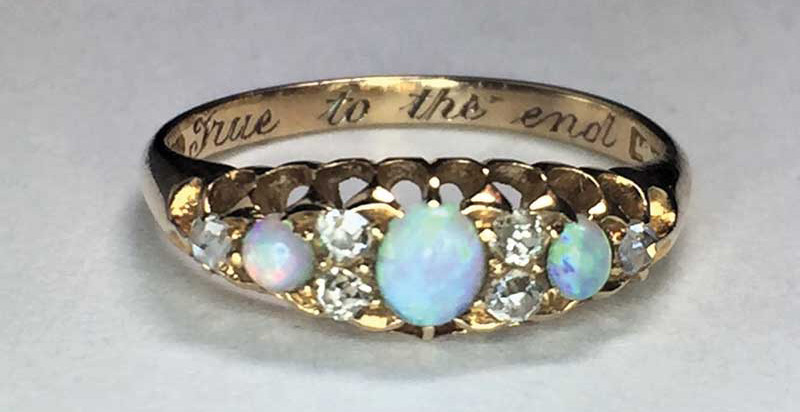 Gold ring with inscription 'True to the end.'