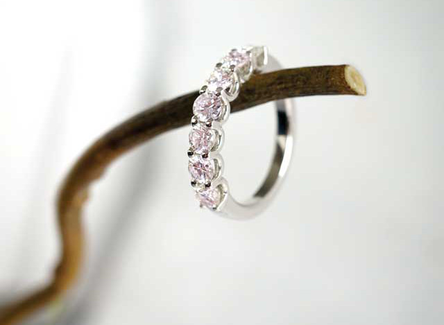 Pink natural colour diamonds can create a soft, pastel look, complementary to most skin tones.