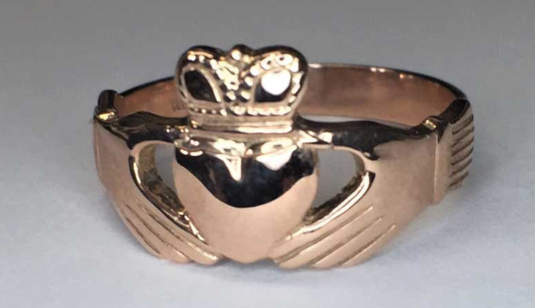 Modern Claddagh ring, featuring heart, hands, and a crown.