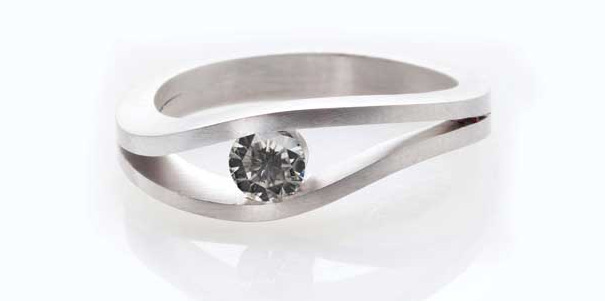Using a tension setting makes a ring's centre stone appear to float in the air, while the lack of prongs allows for a full view of the shape of the diamond.