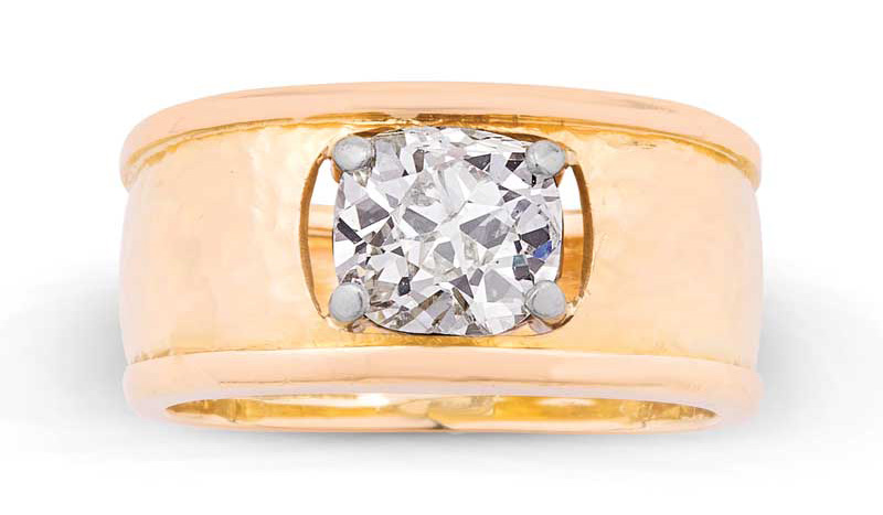 Platinum and gold ring with diamond solitaire by Cavelti.