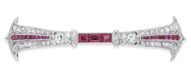 Ruby, diamond, and platinum bar brooch.