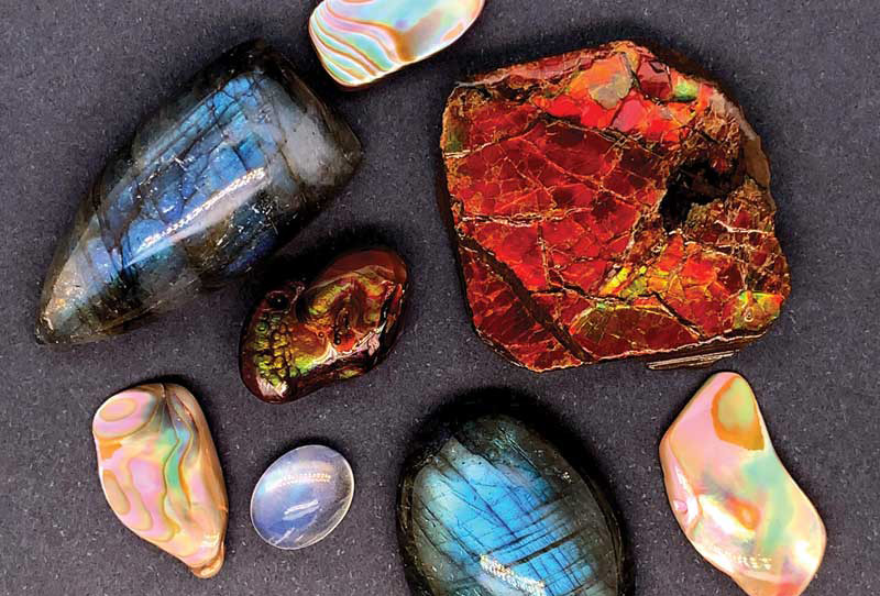 Gemstones showing adularescence (moonstone), labradorescence (Labradorite), orient (nacre), and iridescence (fire agate). Photos by Lauriane Lognay/Rippana Inc.