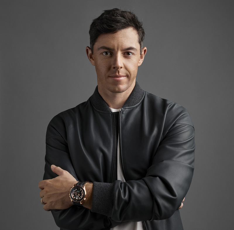 Omega brand ambassador Rory McIlroy wears the Seamaster Diver 300 (Co-Axial Master Chronometer). This 44-mm chronograph model is crafted from the brand's trademarked 18-karat Sedna gold and includes a laser-ablated black ceramic bezel ring with a polished diving scale.