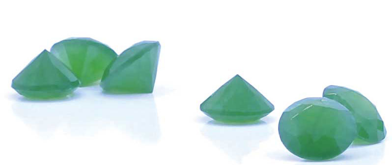 Figure 2: Trademarked 'Jade Diamond:' standard round, brilliant-cut nephrite jade, weighing approximately one carat. Photo by Veronica Cosio/courtesy New Sun Design Group